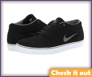 Black Sneakers with White Rubber Bottoms.
