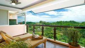 guestroom-balcony-lush-greens-ocean-views