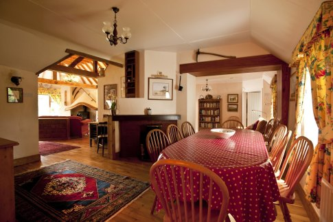Little Orchard Cottage with open plans dining room adjoining living room and reading room.