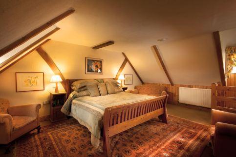 Garden Cottage master suite upstairs with adjoining luxury en-suite bathroom.