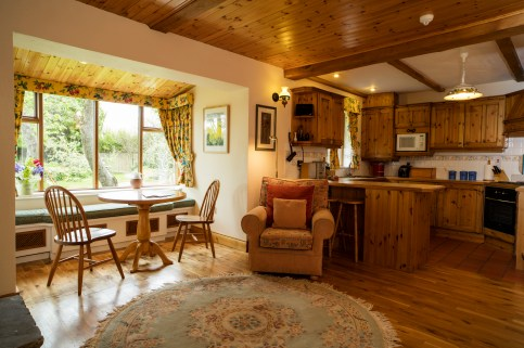 The dining area and kitchen in Garden Cottage