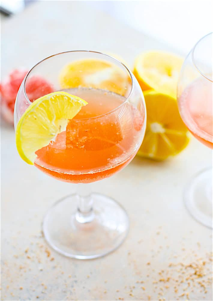 Light and Naturally Sweetened Winter Citrus Paloma Tequila Cocktail! A slightly different twist on the traditional tequila cocktail recipe with a healthy dose of fresh squeezed Vitamin C! Tequila with HEALTH perks! Great for parties and brunch!