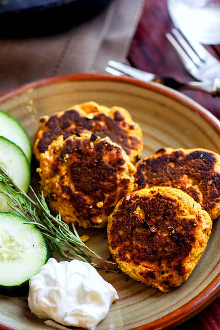 Healthy Vegetable Packed Paleo Salmon Cakes! Super easy, super simple, super delicious! These Paleo salmon cakes take little time. Salmon Cakes that are literally veggie packed and protein packed! Just butternut squash, herbs, egg, salmon, and spices! No wasting leftovers here, just mix and throw on a skillet. Great for a healthy meal, snacks, party appetizers, and are freezer friendly. #whole30 approved. www.cottercrunch.com