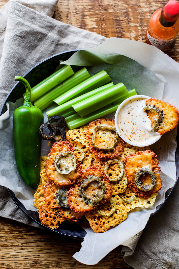 Easy Baked Jalapeno Cheese Crisps! Low carb gluten free cheese crisps with a tex mex flare! These healthier baked crisps are simple to make with minimal ingredients. Plus can be made mild or super spicy. You choose! One of our favorite appetizers and snacks.