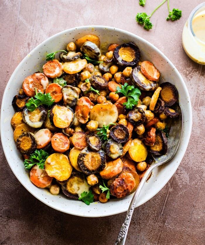Tumeric Roasted Carrot Chickpea Salad with Apple Cider Tahini Dressing. Vegan, grain free, delicious!