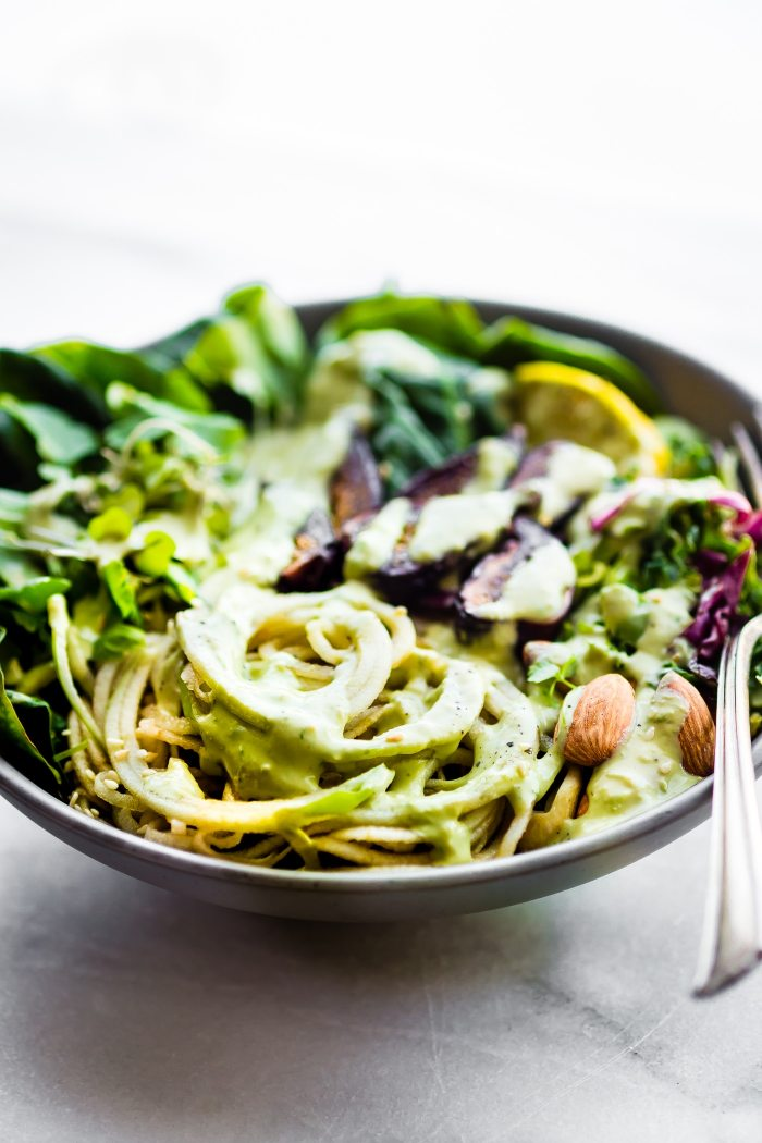 Quick and Easy Green Goddess Fig Nourish Bowls! These plant powered nourish bowls are packed with super greens, healthy fats, nature's candy (Fruit and Figs), and topped with homemade green goddess dressing. They will fill you up and nourish you all at once. Paleo, Vegan, and delicious!