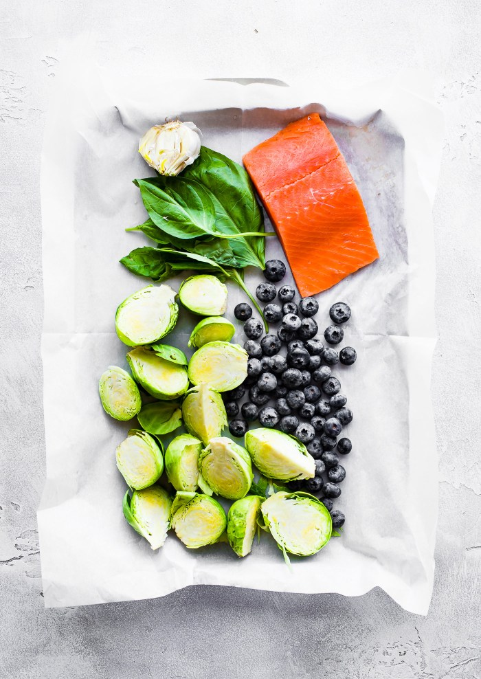 One pan Paleo SUPERFOOD Baked Salmon! This baked salmon recipe is ready in 20 minutes and packed full of nutrients. A nourishing, whole 30 friendly, flavorful meal! And all it takes is just a few simple real food ingredients.