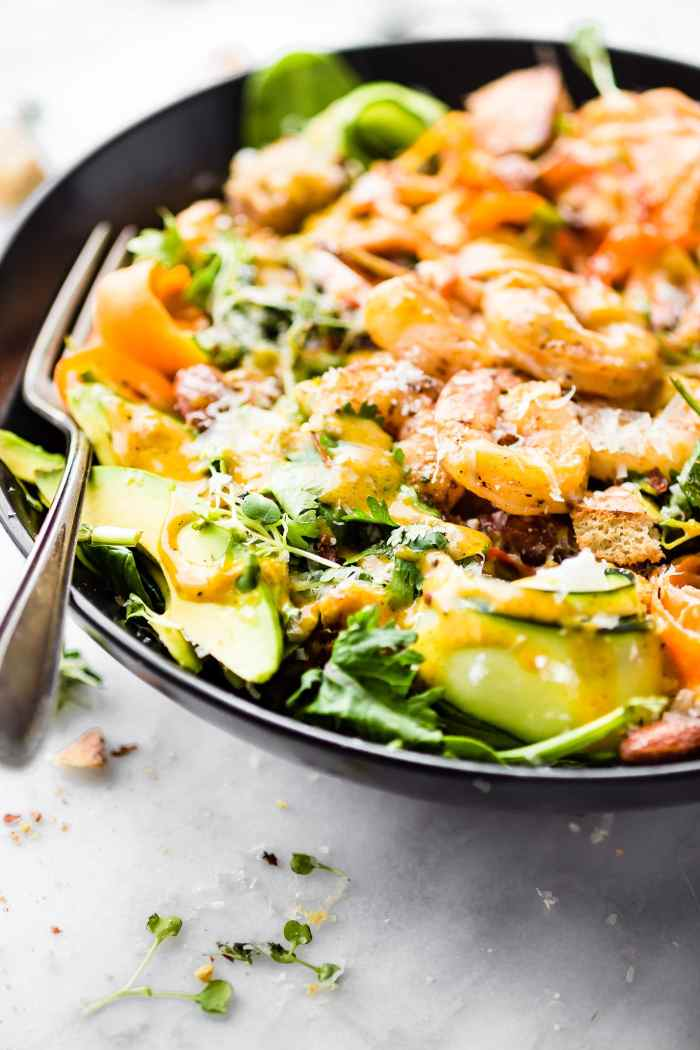 Spicy shrimp Caesar Spinach salad! A quick light meal for lunch or dinner! Spicy shrimp & homemade Caesar dressing make this a flavorful Protein-Rich Salad!