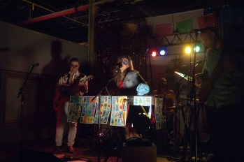 Rosaleen Eastman (center, keyboard), Michael Eastman (left, guitar), Matt Mang (right, bass), Matthew Thomas (center back, drums), and Michael Nordberg (not pictured, guitar) of the Great Party are all smiles at the Hecho Show on September 28, 2013
