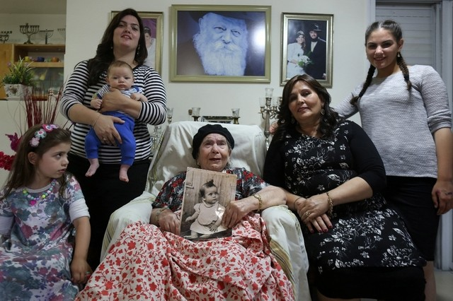 Frecha Amar, 84, an Israeli Jew of Moroccan descent, holds a picture of her baby, who she says was abducted in 1958, at her home in the village of Kfar Chabad, near Tel-Aviv (AFP PHOTO / MENAHEM KAHANA)