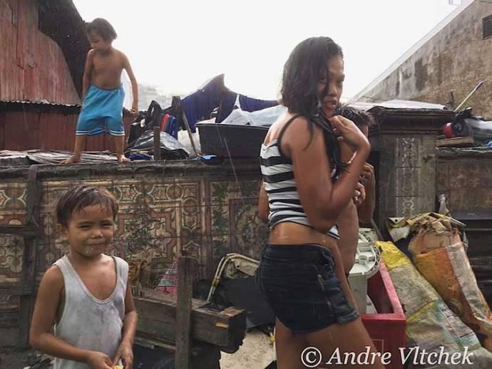 Bathing in the rain in Baseco slum.