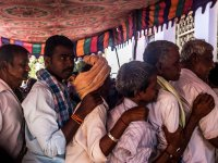 Farmers outside one of the banks in Tadimarri mandal: Farmers like T. Brahmananda Reddy need bulk amounts of the new notes to pay their debts and labourers – and these notes remain scarce at the banks here