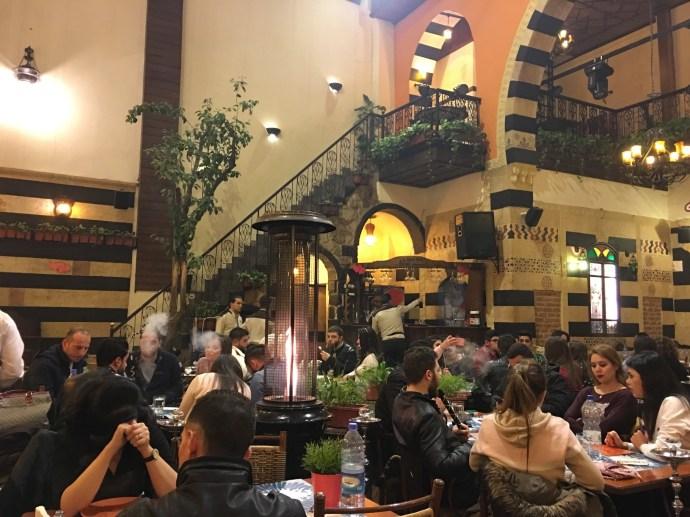Drinking arak and beer smoking shisha in old Damascus