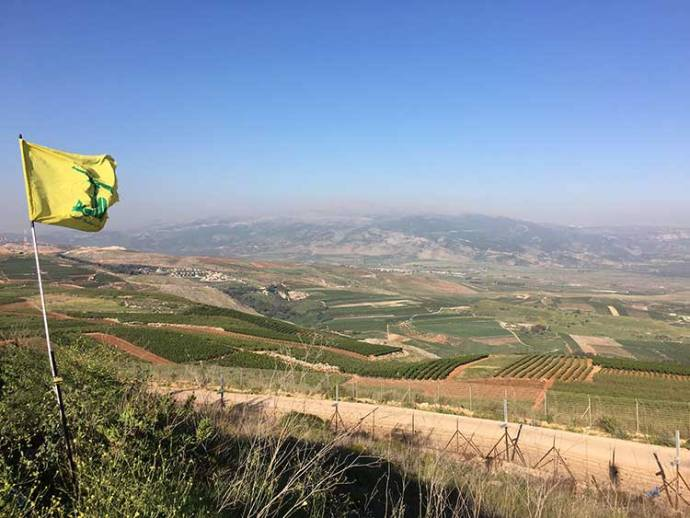 Hezbollah flag over Israeli border