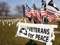 Veterans for Peace, Northwest Michigan Chapter 50 publicly honors fallen Michigan service men and women with flags and crosses on Memorial Day and Veterans Day. Photo Special to the Insider