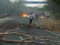 Mandsaur: A scene after violent clashes between farmers and the police at Pipliya in Mandsaur district on Tuesday.  At least five farmers were killed and four others injured in firing by police on farmers, who have been protesting for a week demanding loan waiver and fair price for their produce. PTI Photo  (PTI6_6_2017_000193B)