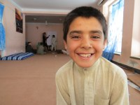 10-year-old Afghan Street Kid Mubasir smiles despite his difficulties