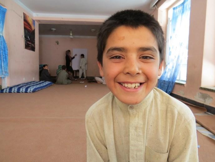 10-year-old Afghan Street Kid Mubasir smiles despite his difficulties