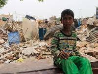 A young boy sits outside his demolished house. Children are most affected  by this eviction as they now lack the place for recreational needs and many have not had food since their parents are busy in collecting/digging household belongings such as stove,Gas, Utensils. (Photographs taken on July6, 2017 )