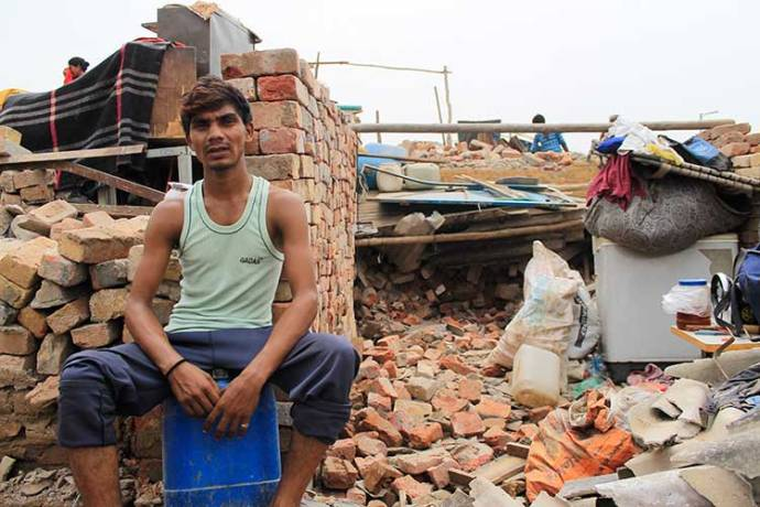 : Narendra (Name Changed), the resident sits outside his demolished house after the eviction that took place on July, 5, 2017