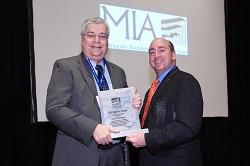 Jeff Matthews (left) accepts the 2014 Lifetime Achievement Award from MIA president Tony Malisani.