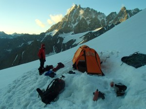 Camp on the 13,500ft shoulder. Dyka Tao, third tallest mountain in Europe, in the background