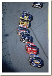 In lap 199 of the Daytona 500, Michael Waltrip (15) leads Dale Earnhardt Jr. (8), Dale Earnhardt Sr. (3), Sterling Marlin (40), Kenny Schrader (36) and Bobby Hamilton; Daytona Beach, FL 02/18/01