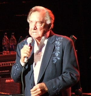 Ray Price pictured singing in later years after he had switched to a more urbane country sound.