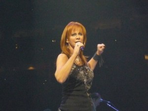 Fan jumps off a building to try to get close to Reba