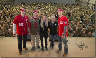 (l-r) Washington Nationals pitcher Craig Stammen, Washington Capitols forward Matt Hendricks, comedian Iliza Shlesinger, critically acclaimed country music singer Kellie Pickler and Washington Nationals pitcher Ross Detwiler pose for a group photo on stage after a USO show for service members stationed at Bagram Air Base in Afghanistan on December 15, 2012. Led by Chairman of the Joint Chiefs of Staff General Martin Dempsey, the tour spans seven-days in four-countries.  USO photo by Fred Greaves