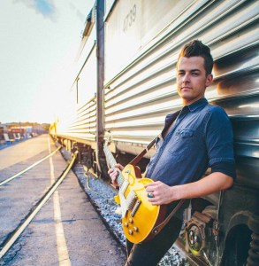 Chase Bryant Surprises Campers With Impromptu Acoustic Concert On Top of Party Bus