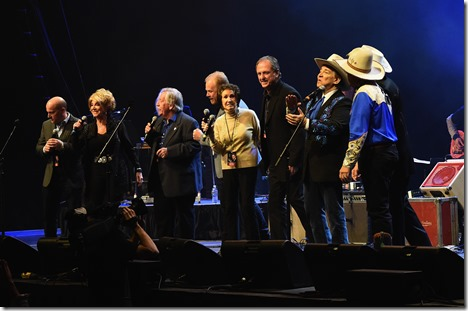NASHVILLE, TN - FEBRUARY 08:  Darrin Vincent of Dailey and Vincent; Jeannie Seely; John Conlee; Jamie Dailey of Dailey & Vincent; Jan Howard; Rudy Gatlin; and Doug Green, Fred LaBour, and Woody Paul of Riders in the Sky perform during 1 Night. 1 Place. 1 Time: A Heroes & Friends Tribute to Randy Travis at Bridgestone Arena on February 8, 2017 in Nashville, Tennessee.  (Photo by Rick Diamond/Getty Images for Outback Concerts)