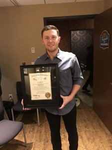 Scotty McCreery receives Order of The Long Leaf Pine Award from the state of North Carolina at the Grand Ole Opry