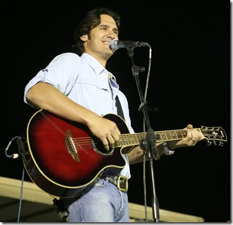 Joe Nichols plays to a crowd of U.S. service members and others at a concert aboard Camp Al Taqaddum, Iraq, June 6, 2009. The show was part of the country music star's ten day tour of the country to honor the men and women who serve in the armed forces. (U.S. Marine Corps photograph by Cpl. Bobbie A. Curtis)