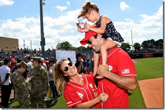 NASHVILLE, TN - JUNE 10: Singer-songwriter Jessie James Decker, NFL player Eric Decker, and their daughter Vivianne Rose Decker attend the 27th Annual City of Hope Celebrity Softball Game at First Tennessee Park on June 10, 2017 in Nashville, Tennessee.  (Photo by Rick Diamond/Getty Images for City Of Hope)