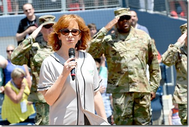 NASHVILLE, TN - JUNE 10:  Musical artist Reba McEntire performs the National Anthem at the 27th Annual City of Hope Celebrity Softball Game at First Tennessee Park on June 10, 2017 in Nashville, Tennesse  (Photo by Rick Diamond/Getty Images for City Of Hope)