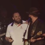 "Couple engaged during Lee and Lewis Brice performance of ""Alabama"""
