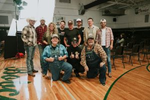 """Aaron Tippin and Shenandoah Cameo in Adam Sanders' star-studded """"Ruled the World"""" music video"""