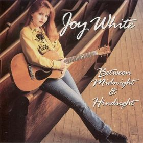 Joy White Between Midnight and Hindsight