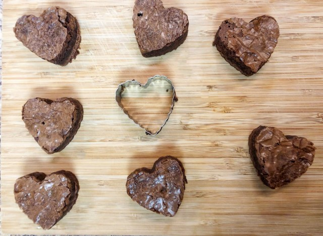 cutting heart brownies with a cookie cutter