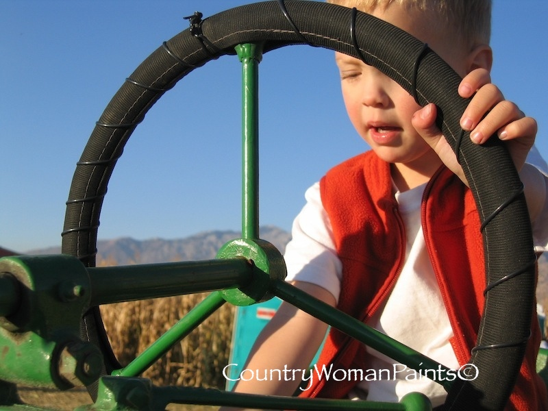 small boy on a tractor