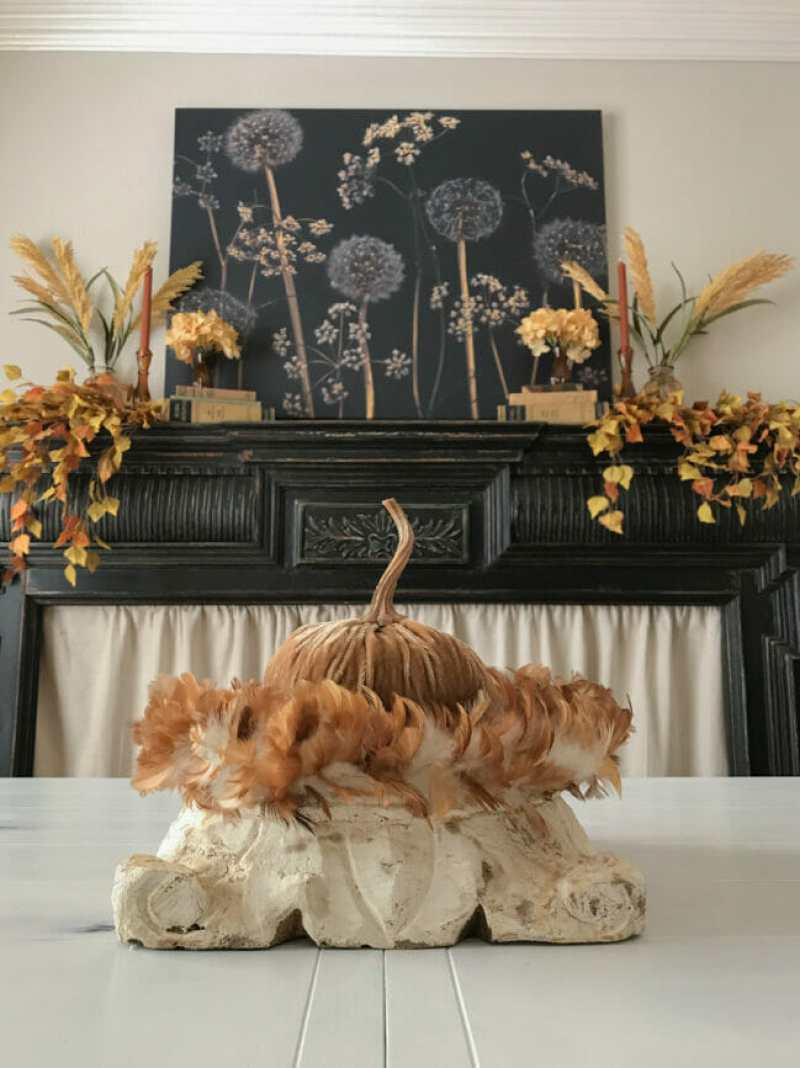 Autumn print over black mantel with fall decor