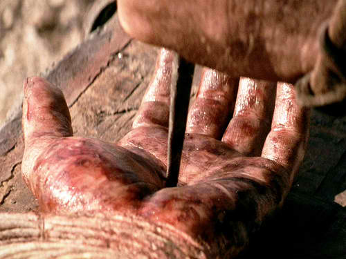 Nail Pierced Hands of The Ultimate Superhero