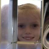Addie Lynn pears through the Post Office Box - Photo KSL
