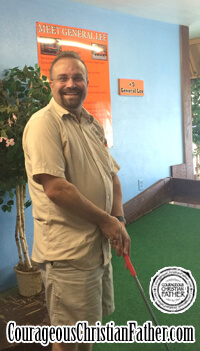 Steve at Cooter's Playing Mini-Golf at the General Lee Hole