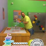 Steve touching the Static Ball at Creative Discovery Museum