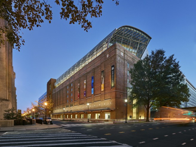 Museum of the Bible Celebrates More than Half a Million Visitors in First Six Months - Museum of the Bible - Exterior nighttime photo of Museum of the Bible; intersection of 4th St SW and D St SW, facing southeast. Photo by Alan Karchmer