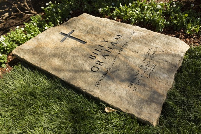 "A slab of North Carolina stone marks the grave of Billy Graham, buried next to his wife, Ruth, at the Prayer Garden located next to the Billy Graham Library in Charlotte. The marker inscription bears the text, ""Preacher of the Gospel of the Lord Jesus Christ"" with the Scripture reference, John 14:6. (Billy Graham's Grave Marker)"