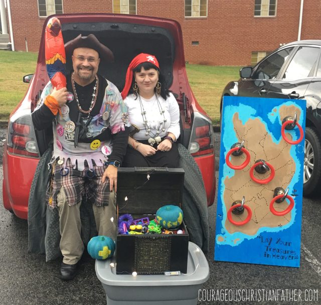 Cap'n ChristianBlogR and SimplySpokn at Trunk or Treat 2018 along with the Pirate Chest and Pirate Ring Toss Game.