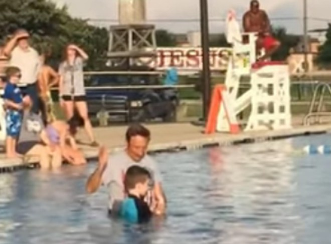 Boy Gets Baptized and a Jesus Truck Passes in background - Watch the truck in the background right before he gets baptized.